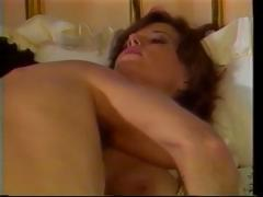 Vintage porn with this brunette hair engulfing and fucking hard cock